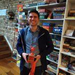 Winner of Azul tournament holding trophy